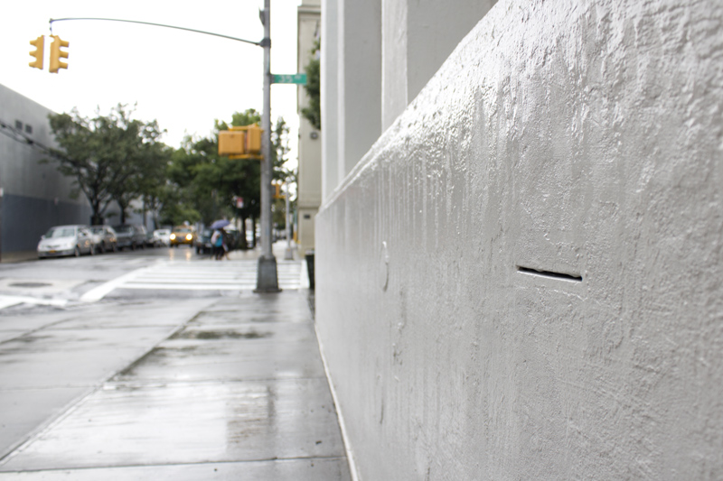 DVD Dead Drop installed outside of the Museum of Moving images in NYC